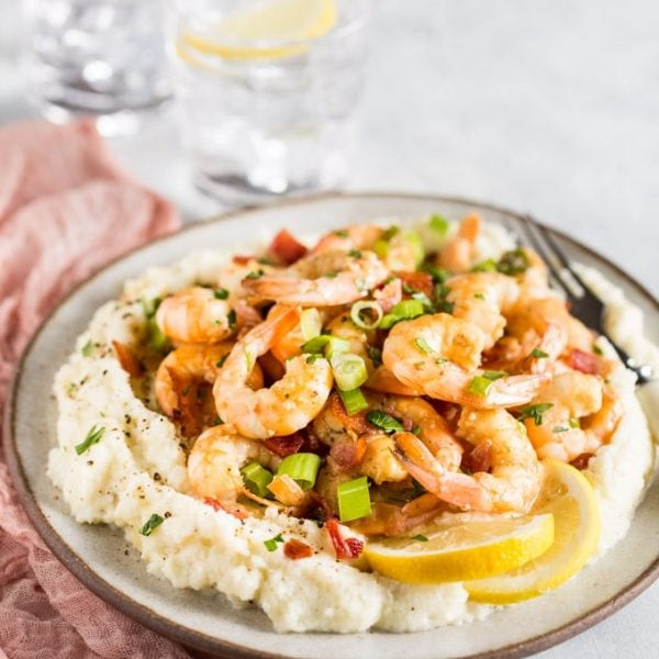 Keto Shrimp and Grits recipe that is just PERFECTION on a plate, it doesn't get any better than this!! With cheesy, yummy, grain free 'grits' you'll be coming back for more!! This keto low carb shrimp recipe comes together in next to no time and is a really easy weeknight family meal that can double as a fancy dinner party menu item too, you're going to LOVE it! | www.noshtastic.com | #lowcarb #noshtastic #glutenfree #keto #shrimp #grits #shrimpandgrits #ketodiet #ketogenic #ketorecipes #ketogenicdiet #cheese #cheddar #whitecheddar