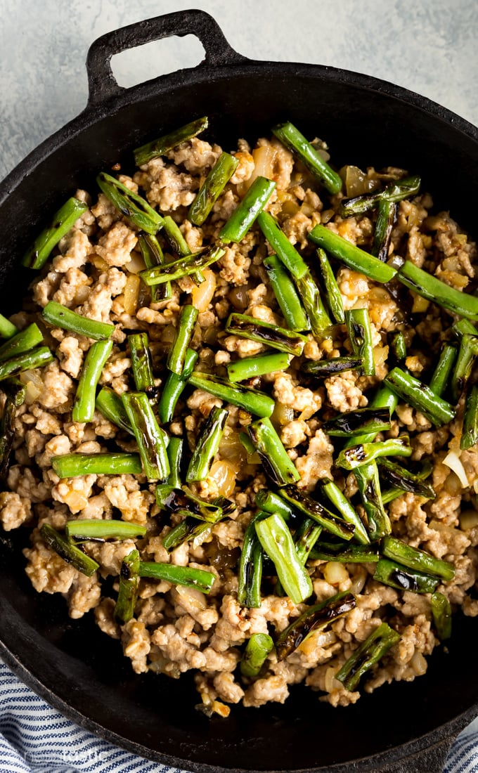 pork stir fry with green beans in a skillet