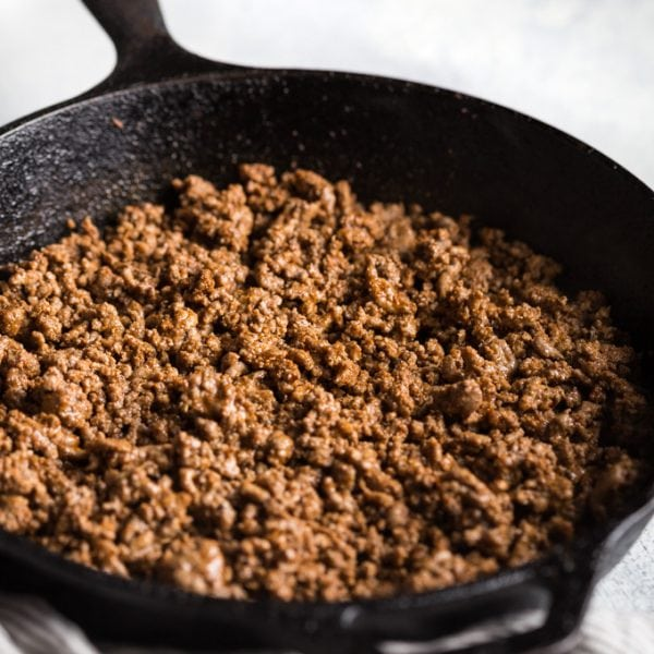 Taco meat cooked in cast iron skillet