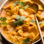 Butter Chicken in a large dish on table