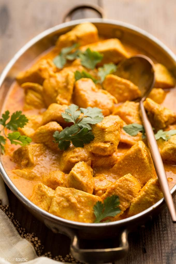 butter chicken in a copper bowl