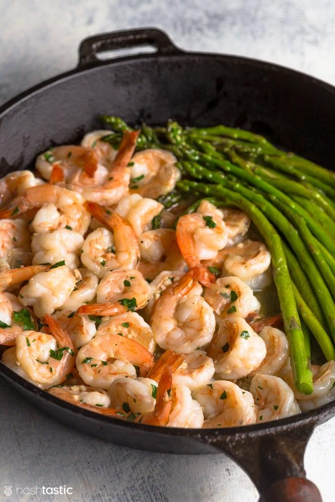 garlic butter shrimp in a skillet