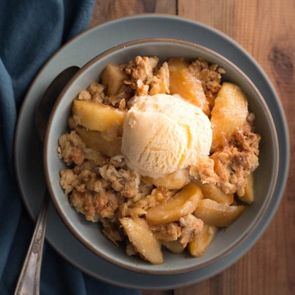 Gluten Free Apple Crisp in a bowl with scoop of ice cream