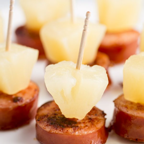 Sausage pineapple bites on a plate
