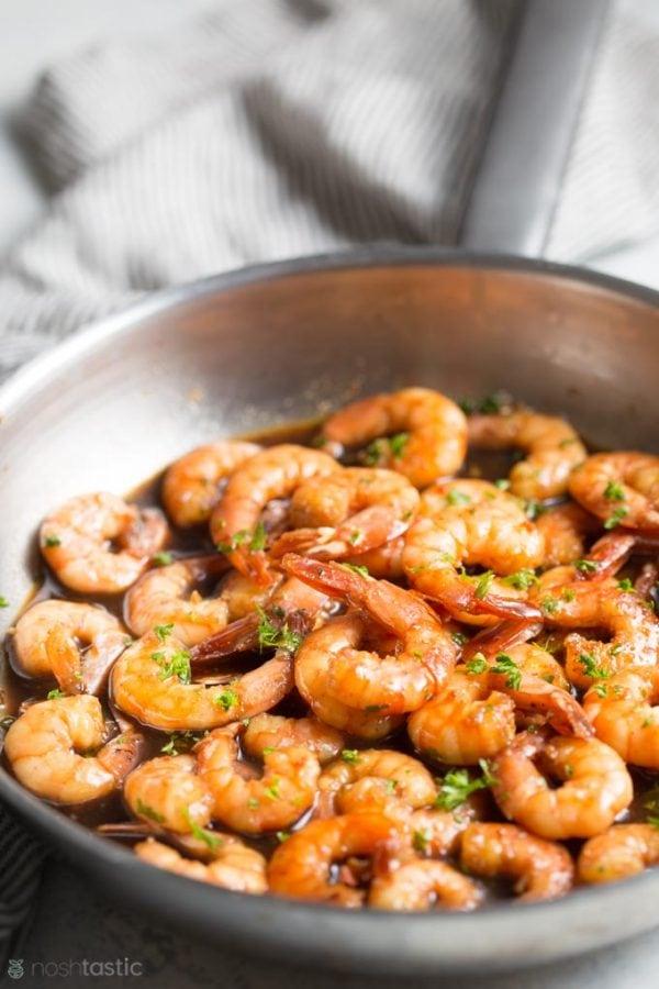 Honey garlic shrimp with sauce in a skillet