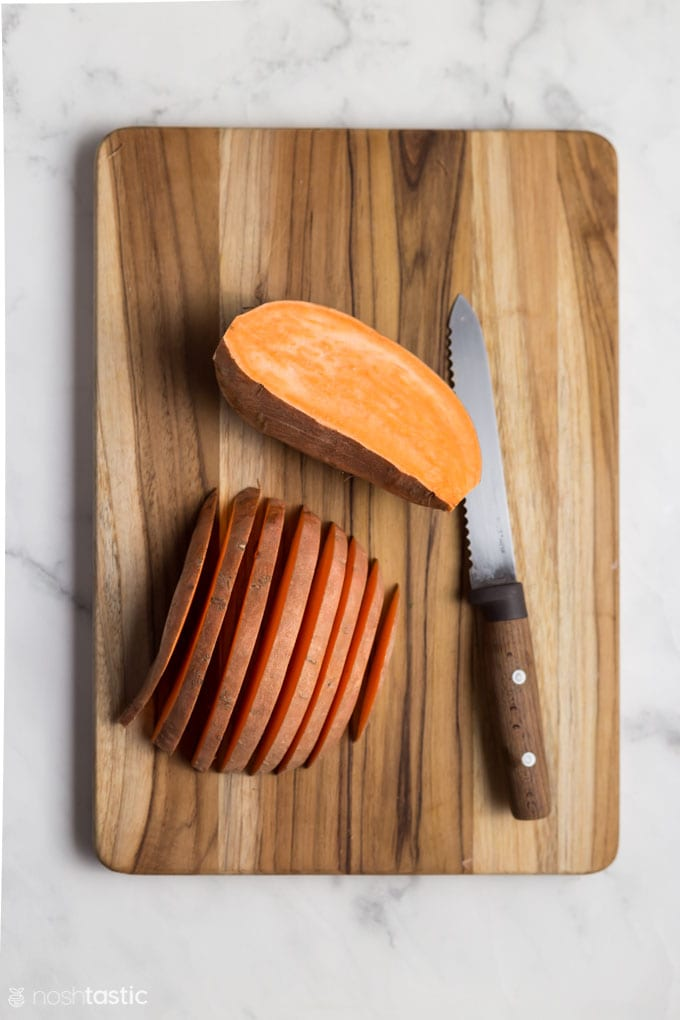 Sliced sweet potatoes on a board