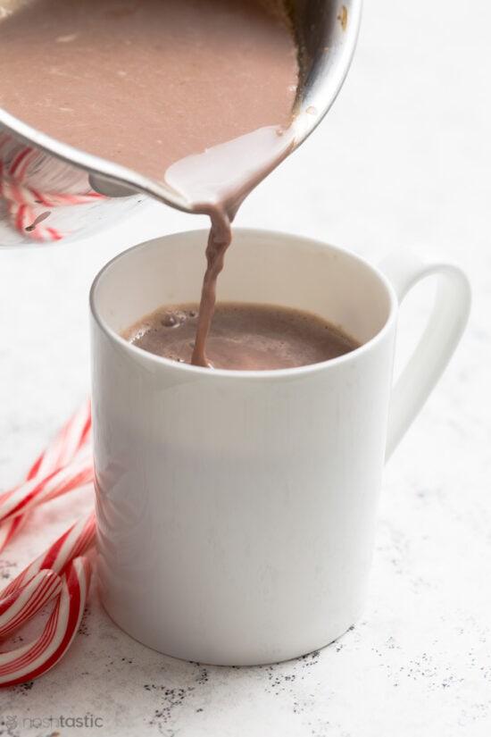 hot chocolate poured into a mug
