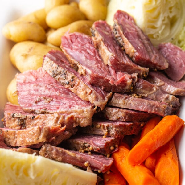 Sliced corned beef with cabbage, carrots, and potatoes