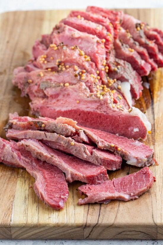 sliced corned beef on a board