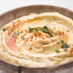 Hummus with paprika topping in a bowl