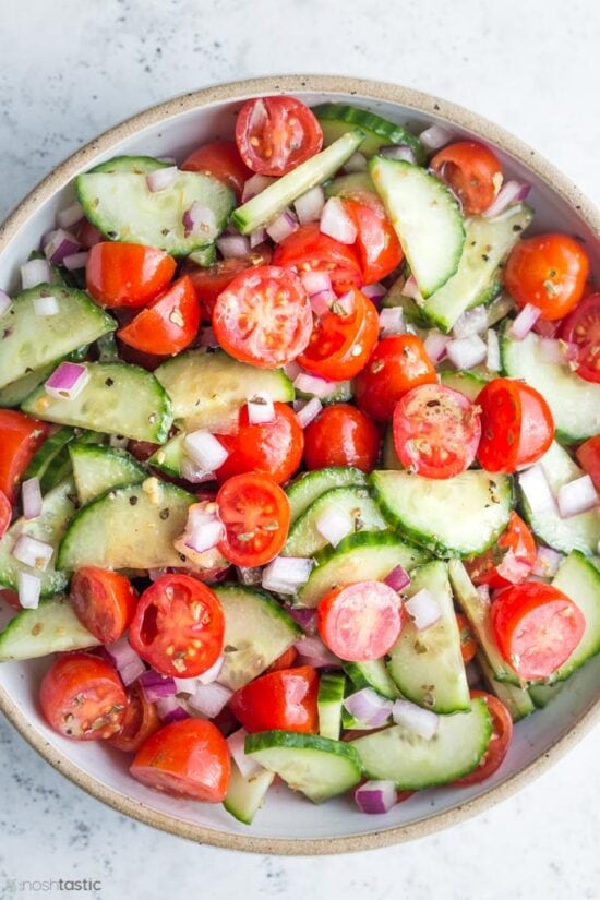 cucumber tomato salad in bowl