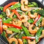 shrimp stir fry in cast iron skillet