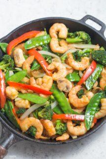 shrimp stir fry in cast iron skillet