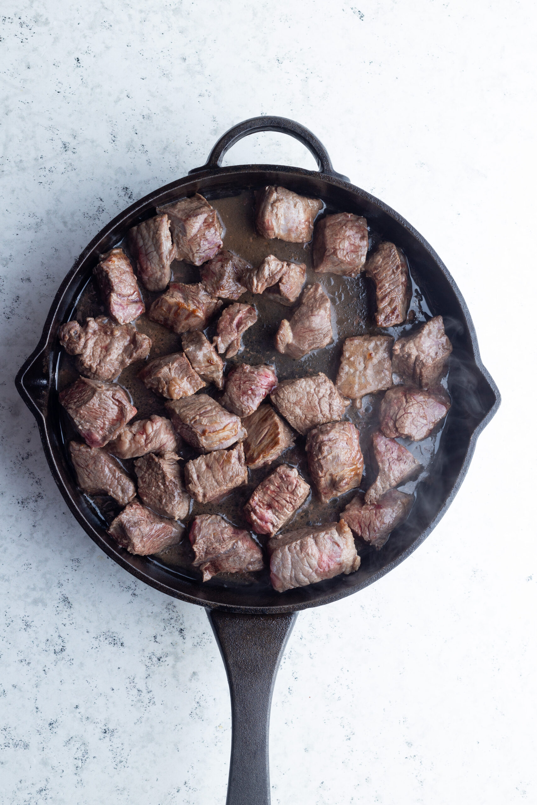 beef chunks in a skillet