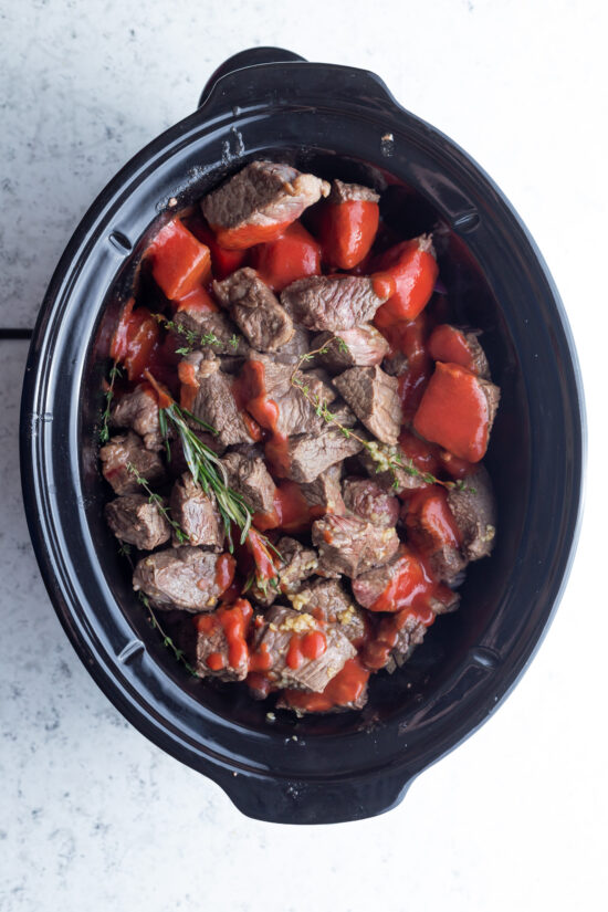beef stew ingredients in a slow cooker