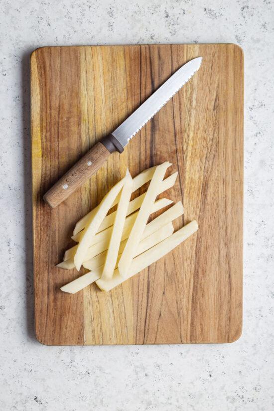 hand cut fries on a board